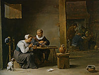 A man and woman smoking a pipe seated in an interior with peasants playing cards on a table, teniers